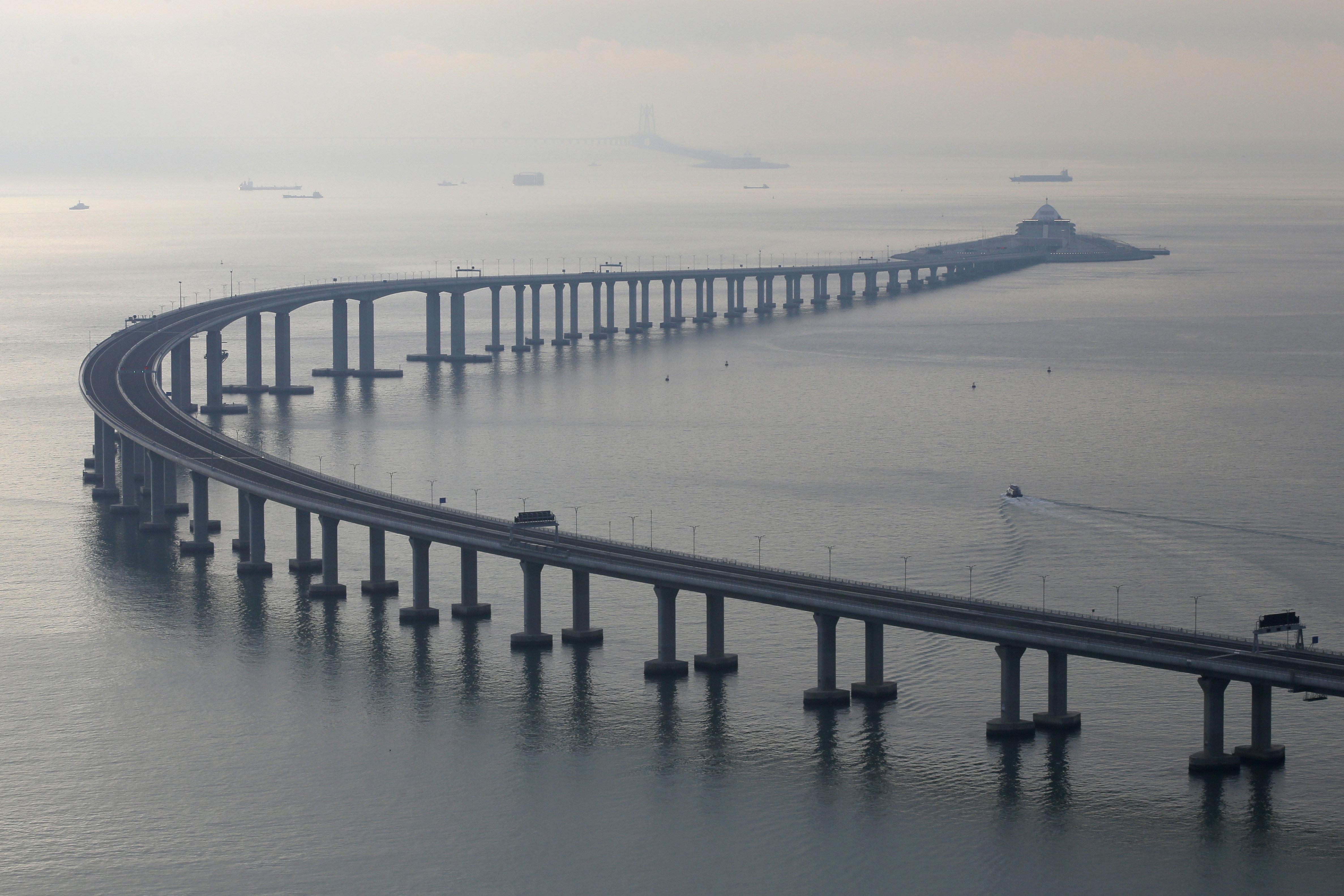 The 34-mile Hong Kong-Zhuhai-Macau bridge was officially opened on Tuesday.