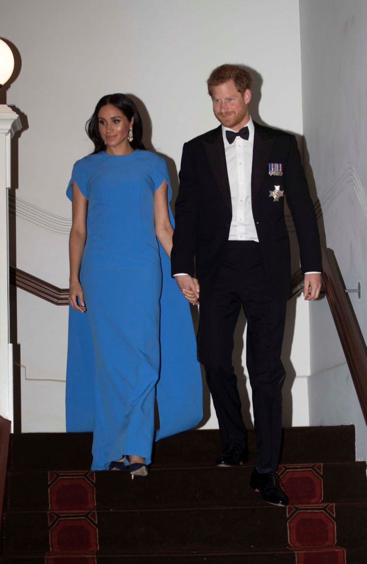 Prince Harry and Meghan, the Duchess of Sussex, arrive for a reception and state dinner at the Grand Pacific Hotel in Suva, Fiji, on Oct. 23.