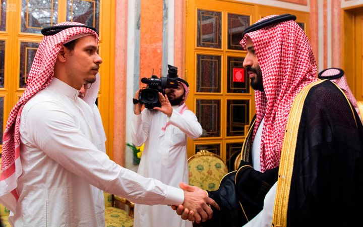 Saudi Crown Prince Mohammed bin Salman (right) shakes hands with Salah Khashoggi, son of Jamal Khashoggi, in Riyadh on Oct. 2