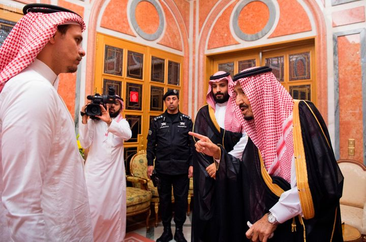 King Salam (right) speaks to Salah Khashoggi during the photo op.