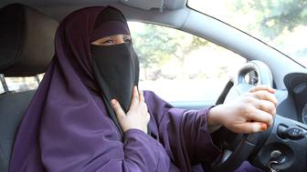 France's Kenza Drider , wearing a niqab,  drives a car  in Avignon, southern France, Monday, Sept. 13, 2010.   A ban on the burqa-style veil, to be voted on Tuesday in the Senate, would affect only a tiny minority of Muslim women _ estimated at less than 2,000 _ making it far less controversial than France's 2004 ban on Muslim headscarves in classrooms, which proliferated in heavily immigrant neighborhoods. (AP Photo/Claude Paris)
