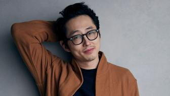 """Steven Yeun poses for a portrait to promote the film, """"Sorry to Bother You"""", at the Music Lodge during the Sundance Film Festival on Sunday, Jan. 21, 2018, in Park City, Utah. (Photo by Taylor Jewell/Invision/AP)"""