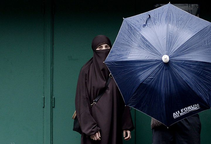 A woman wearing a niqab in Paris in 2014. The U.N. Human Rights Committee declared that France's ban on full-face Islam