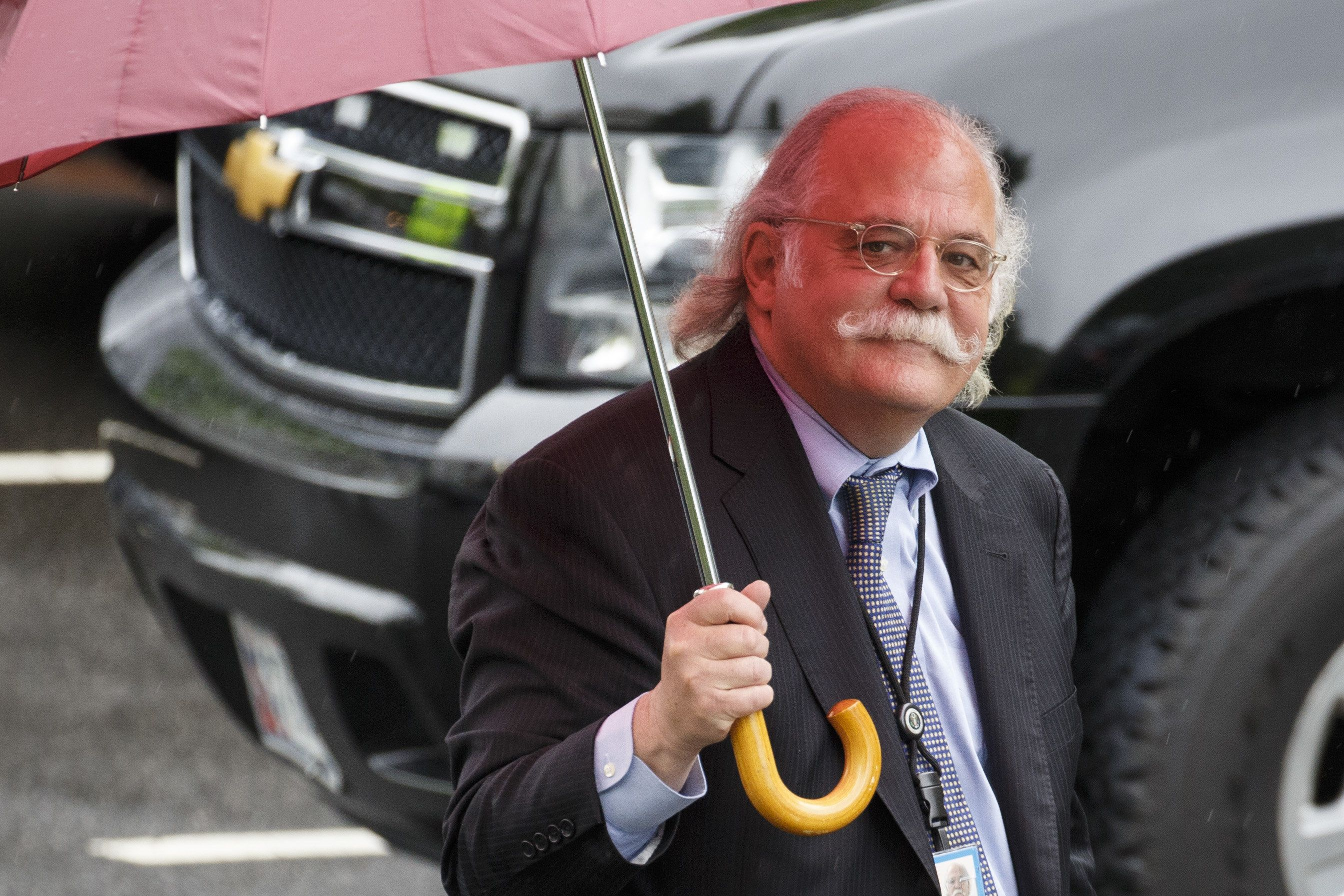 Ty Cobb, White House special counsel, holds an umbrella while walking near the White House in Washington, D.C., U.S., on Thursday, May 17, 2018. President Donald Trump has been escalating his attacks on Robert Mueller and his team since March after months of restraint at the urging of Cobb, who announced his departure earlier this month. Photographer: Joshua Roberts/Bloomberg via Getty Images