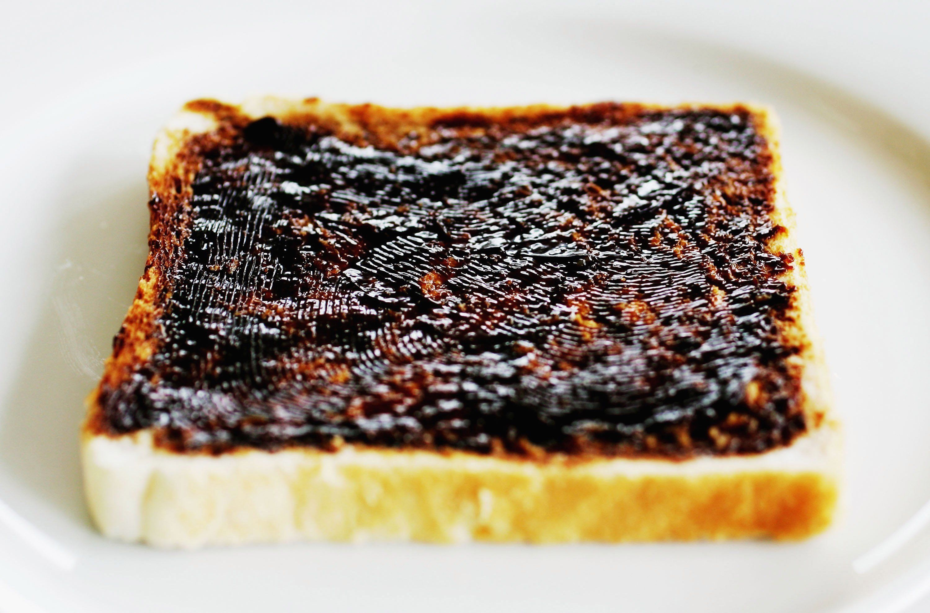 SYDNEY, NSW - JANUARY 25:  A Vegemite sandwich is pictured January 25, 2006 in Sydney, Australia. Vegemite, an Australian culinary specialty, is concentrated yeast extract originally made from a by-product of the beer brewing process. An estimated nine out of ten Australian pantries contain at least one jar of Vegemite, with 46% of Australians having eaten Vegemite at least once during a calendar week. The Vegemite sandwich, a staple of Australian school lunch boxes, was immortalised in the Men At Work song 'Down Under' in 1982. The nation will celebrate Australia Day on January 26.  (Photo Illustration by Ian Waldie/Getty Images)