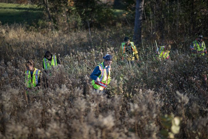 Volunteers search for evidence in the woods and fields near Jayme Close's home in Barron, Wisconsin.