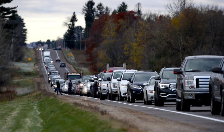 Volunteers line up along Highway 25 just north of Barron on Oct. 23, 2018, to assist in the search for Jayme Closs.