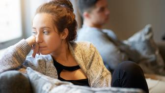 Shot of a young woman looking despondent after a fight with her boyfriend