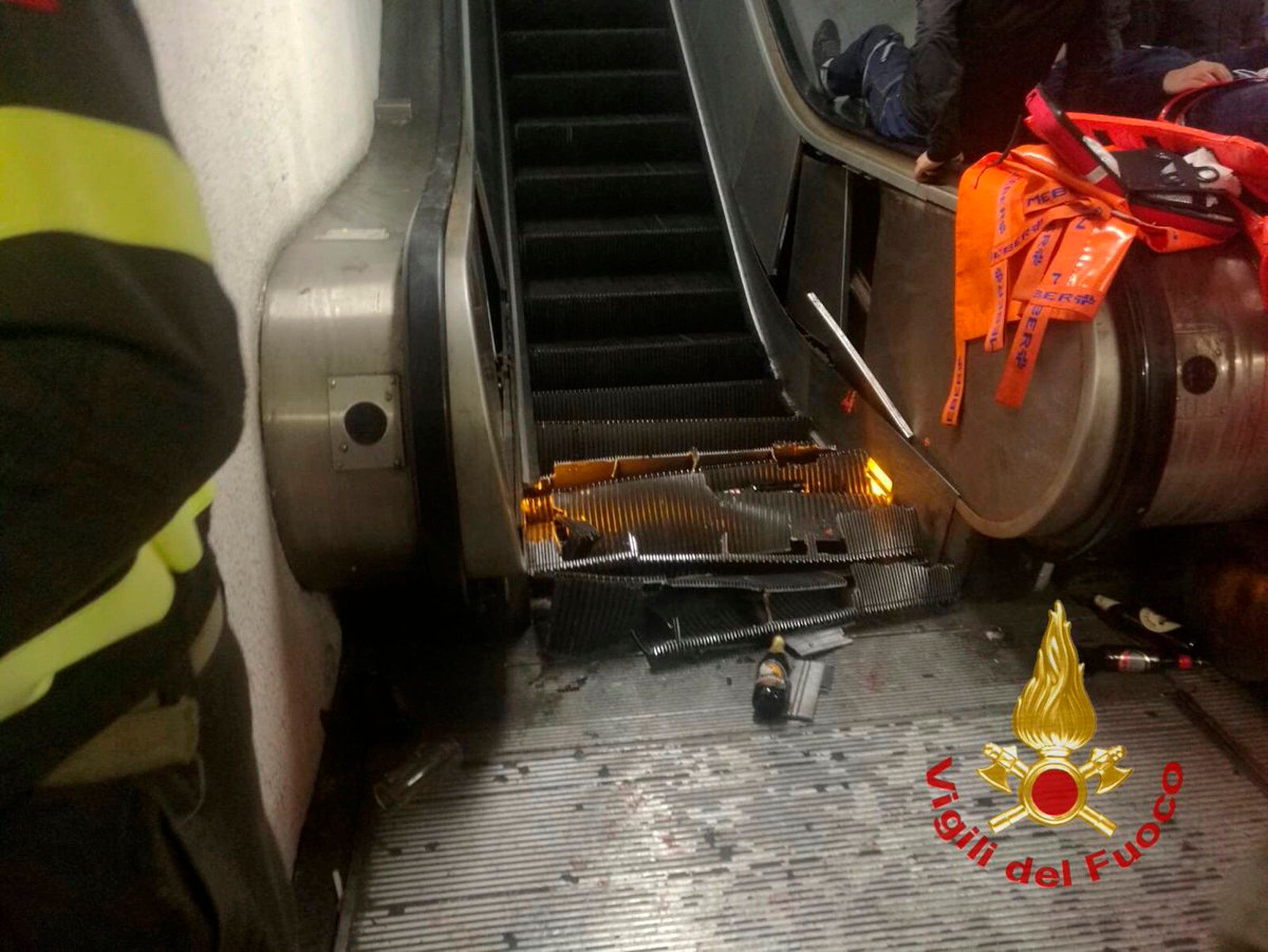 "A view of the crashed escalator at the ""Repubblica"" subway station in Rome, Tuesday, Oct. 23, 2018. Many of the people wounded in the accident were reportedly fans of CSKA Moscow, who were in Rome for tonight's Champions League soccer match against Roma. (Vigili del Fuoco via AP)"