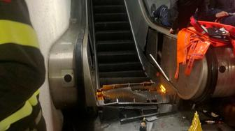 """A view of the crashed escalator at the """"Repubblica"""" subway station in Rome, Tuesday, Oct. 23, 2018. Many of the people wounded in the accident were reportedly fans of CSKA Moscow, who were in Rome for tonight's Champions League soccer match against Roma. (Vigili del Fuoco via AP)"""