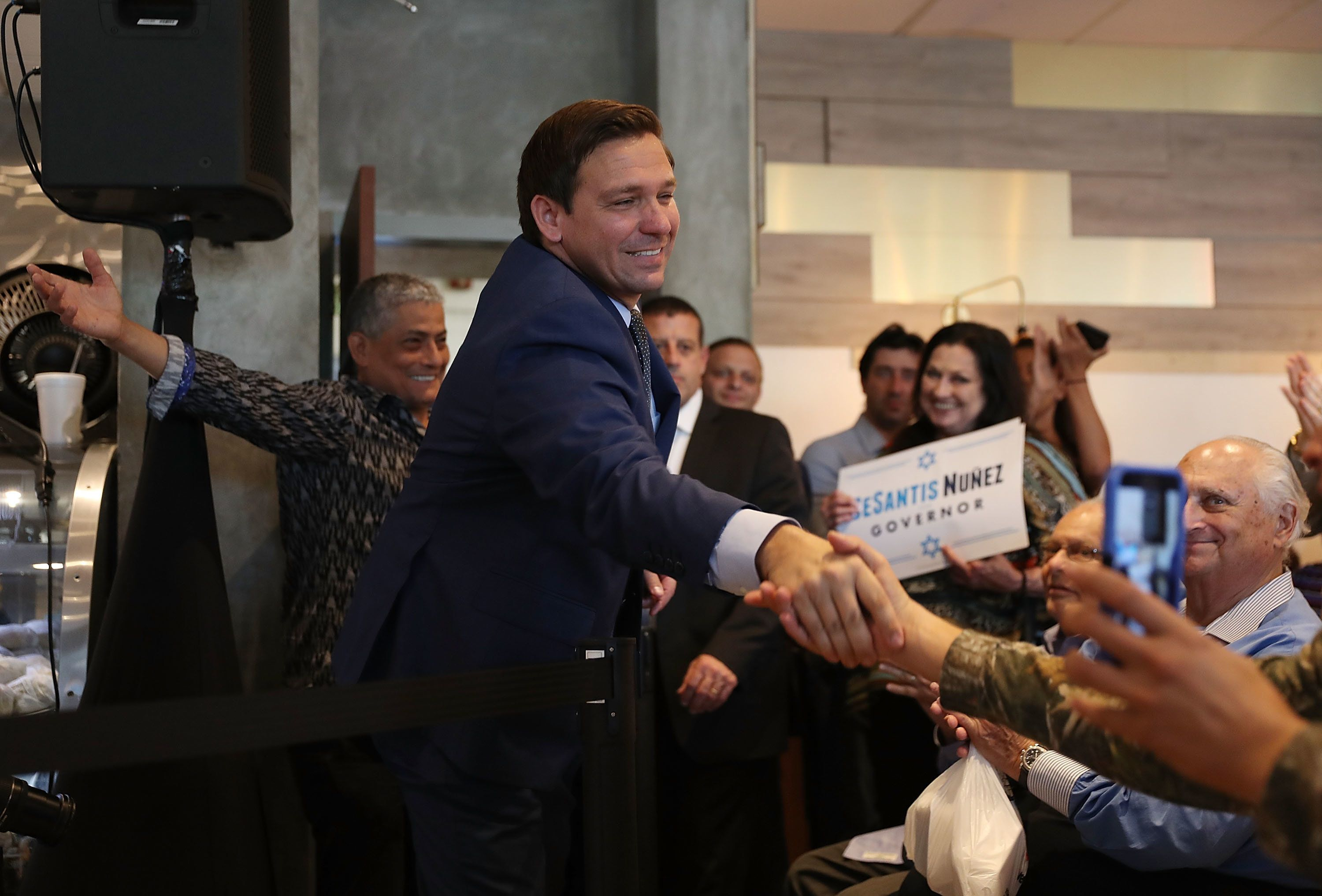 MIAMI, FL - OCTOBER 23:  Republican gubernatorial candidate Ron DeSantis greets people as he arrives for a campaign rally at Mo's Bagels restaurant on October 23, 2018 in Miami, Florida. DeSantis is facing off against Democratic challenger Andrew Gillum to be the next Florida governor.  (Photo by Joe Raedle/Getty Images)