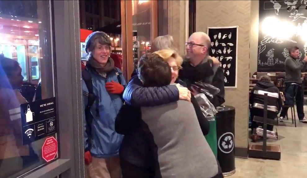 Customers being greeted in Starbuck's first deaf-friendly store in the United States.