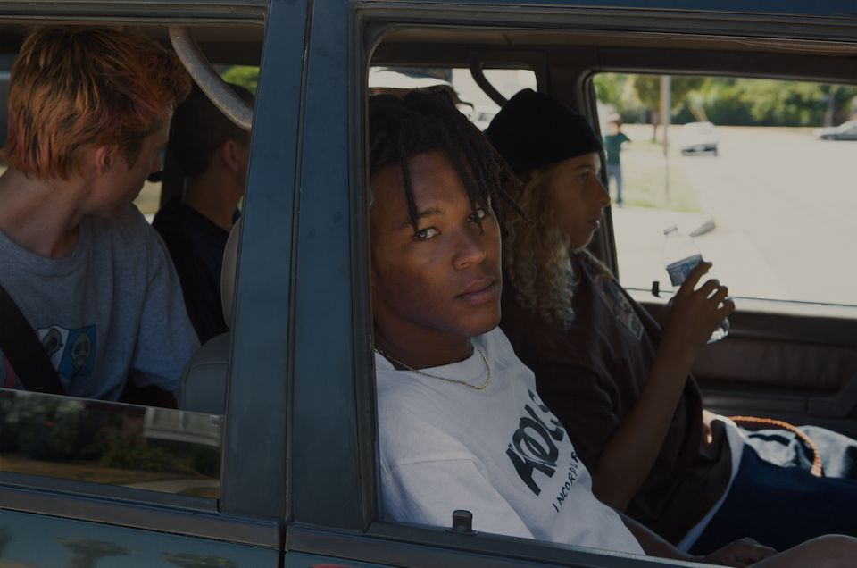 Na-kel Smith, who plays Ray, stares out from a car during the making of