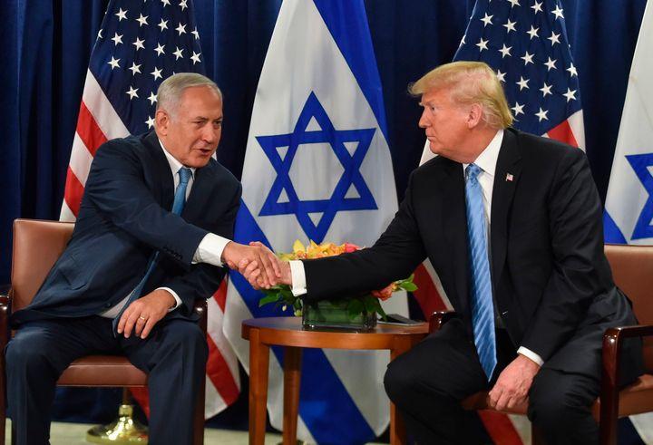 President Donald Trump shakes hands with Israeli Prime Minister Benjamin Netanyahu.