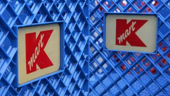 SAN MATEO, CA - MARCH 24:  Shopping carts with  the K-Mart logo are seen at a K-Mart store March 24, 2005 in San Mateo, California. Shareholders agreed on Kmart Holding Corp.'s $12.3 billion acquisition of Sears, Roebuck and Co., helping the two struggling rivals to combine into the nation's third-largest retailer. (Photo by Justin Sullivan/Getty Images)