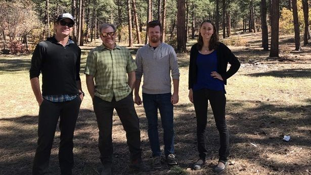 Anthony Culpepper, Aaron Kimple, Matt Cook and Laurel Sebastian — all of the Mountain Studies Institute — stand in a clearing