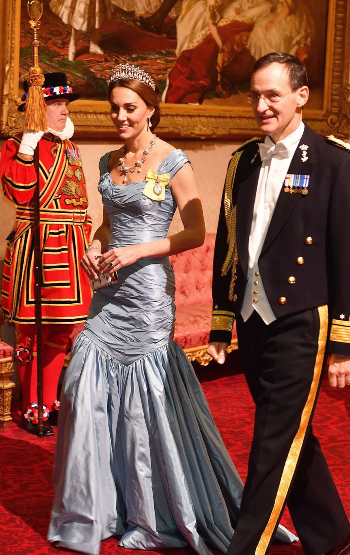 Catherine, Duchess of Cambridge, walks with Rear Admiral Ludger Brummelaar (R) as they attend a state banquet in honor of Kin