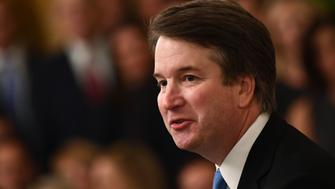 Brett Kavanaugh speaks after being sworn-in as Associate Justice of the US Supreme Court on October 8, 2018 at the White House in Washington, DC. (Photo by Brendan Smialowski / AFP)        (Photo credit should read BRENDAN SMIALOWSKI/AFP/Getty Images)