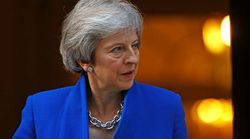 May Wins Reprieve From Tory MPs After 'Emotional' Brexit