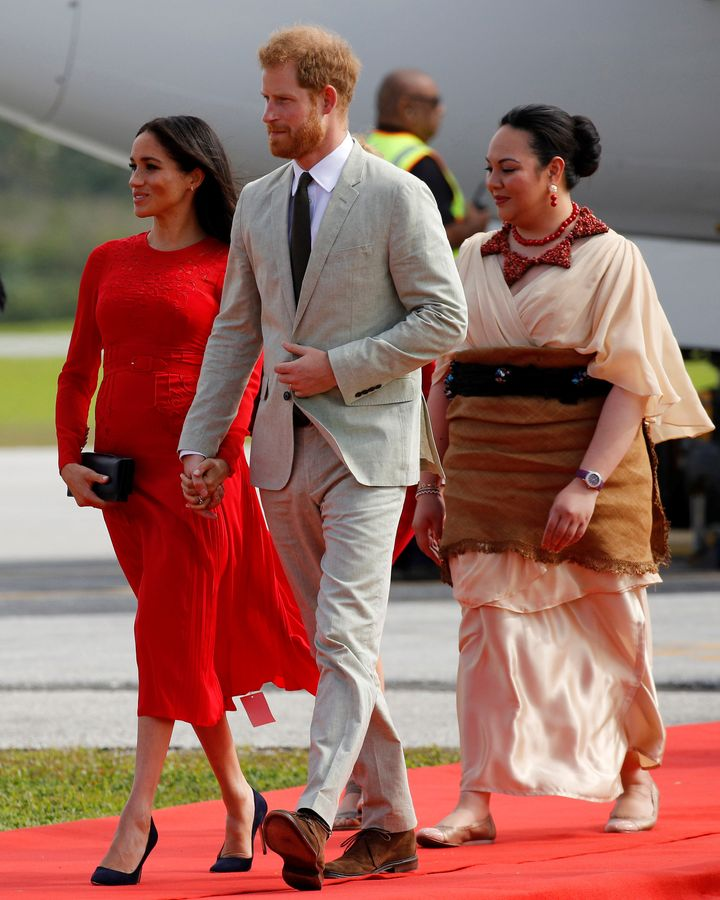 The Duchess of Sussex (and her label) with Prince Harry and Tonga's Princess Latufuipeka Angelika Tuku'aho.