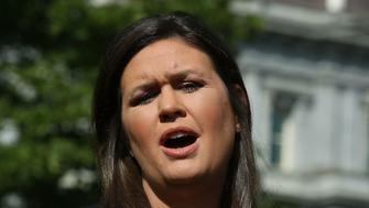 WASHINGTON, DC - OCTOBER 04:  White House Press Secretary Sarah Huckabee Sanders speaks to the media in front of the West Wing of the White House, on October 4, 2018 in Washington, DC.  Sanders has been pressed recently about the Kavanaugh investigation and President Trump's tax history. (Photo by Mark Wilson/Getty Images)