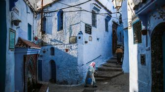 Women walk in an alleyway in the Medina of Chefchaouen, a picturesque town well-known for its blue painted houses and alleyways, in northern Morocco, Thursday, April 27, 2017. (AP Photo/Mosa'ab Elshamy)