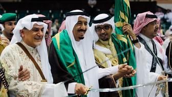 Saudi Prince Turki al-Faisal (L) and Saudi Prince Salman (2nd L) perform a traditional dance during the 26th Janadriya Heritage and Culture Festival on the outskirts of Riyadh April 19, 2011. REUTERS/Fahad Shadeed  (SAUDI ARABIA - Tags: POLITICS ROYALS)