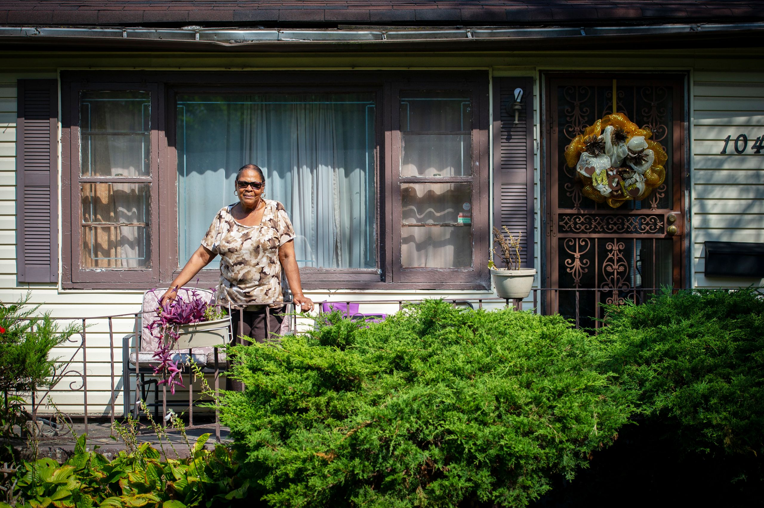 Ida Sain, 75, stands on the front porch of her house on Sept. 19, 2018. It's been her home since 1972. Behind her property, a