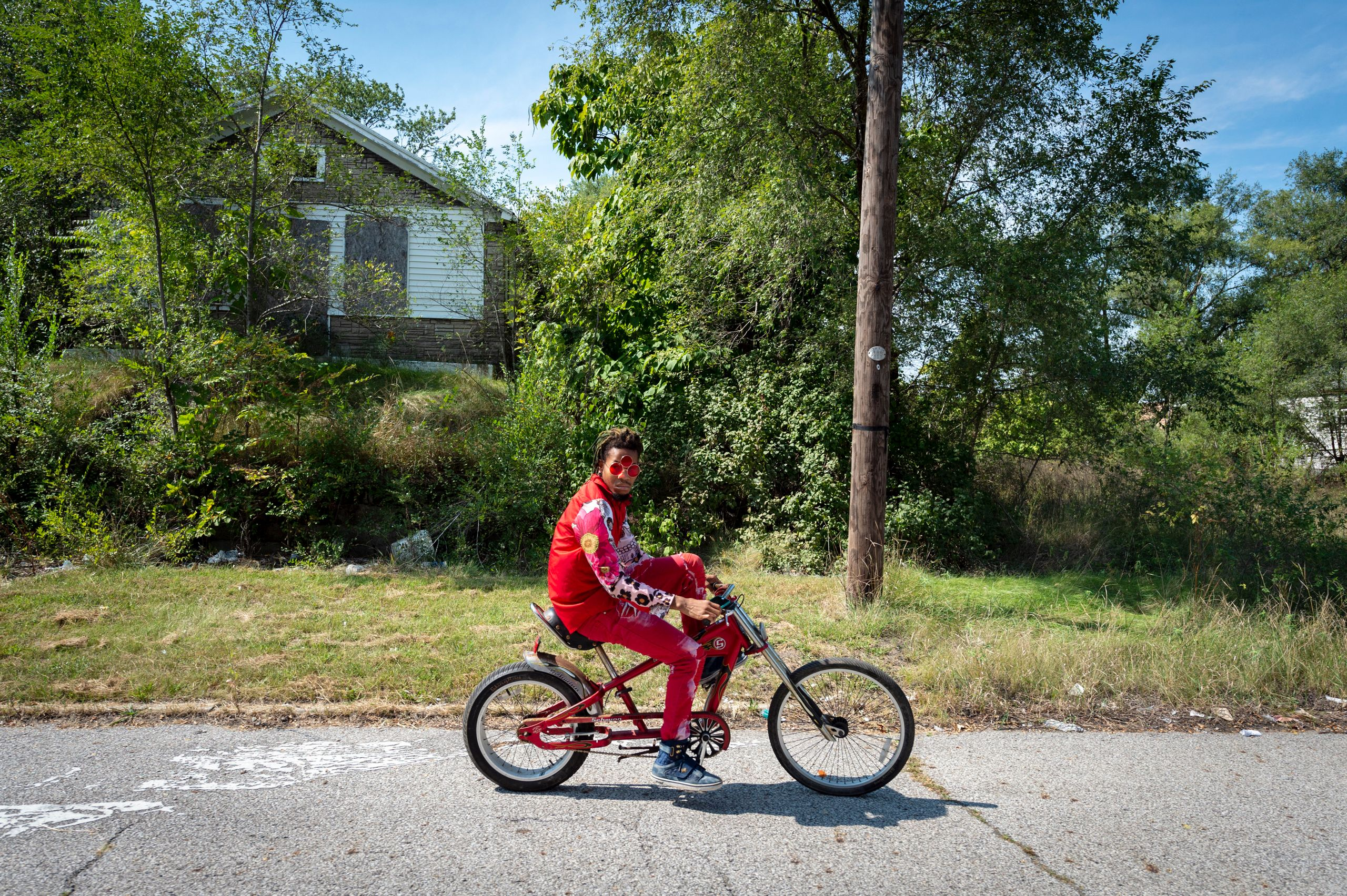 Chris Grant, a 24-year-old dancer in Gary, rides his bike through the neighborhood where he has lived for three years and whe