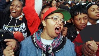 Carolyn Mungin, from Washington, D.C., joins participants of the Million Women March as they sing the Black National Anthem, in Philadelphia October 25. Thousands of black women marched through Philadelphia in a massive show of unity against inadequate health care, poor education, high unemployment and crime. The Million Woman March brought women by the busload from across the United States for a daylong program of prayer, music and inspirational speeches, intended as a catalyst for positive change in black communities.  USA MARCH