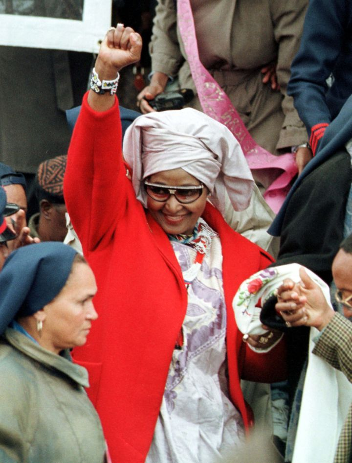 Winnie Madikizela-Mandela (former wife to Nelson Mandela) salutes the crowd with a fist as she exits the Million Woman March