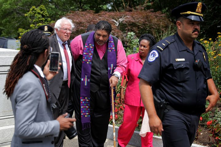 Sanders and Rep. Sheila Jackson Lee (D-Texas) walked with Rev. William Barber of North Carolina, a civil rights leader, durin