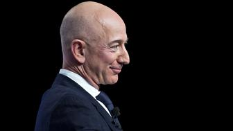 Jeff Bezos, founder and chief executive officer of Amazon.com Inc., listens during a discussion at the Air Force Association's Air, Space and Cyber Conference in National Harbor, Maryland, U.S., on Wednesday, Sept. 19, 2018. Amazon is considering a plan to open as many as 3,000 new AmazonGo cashierless stores in the next few years, according to people familiar with matter, an aggressive and costly expansion that would threaten convenience chains. Photographer: Andrew Harrer/Bloomberg via Getty Images