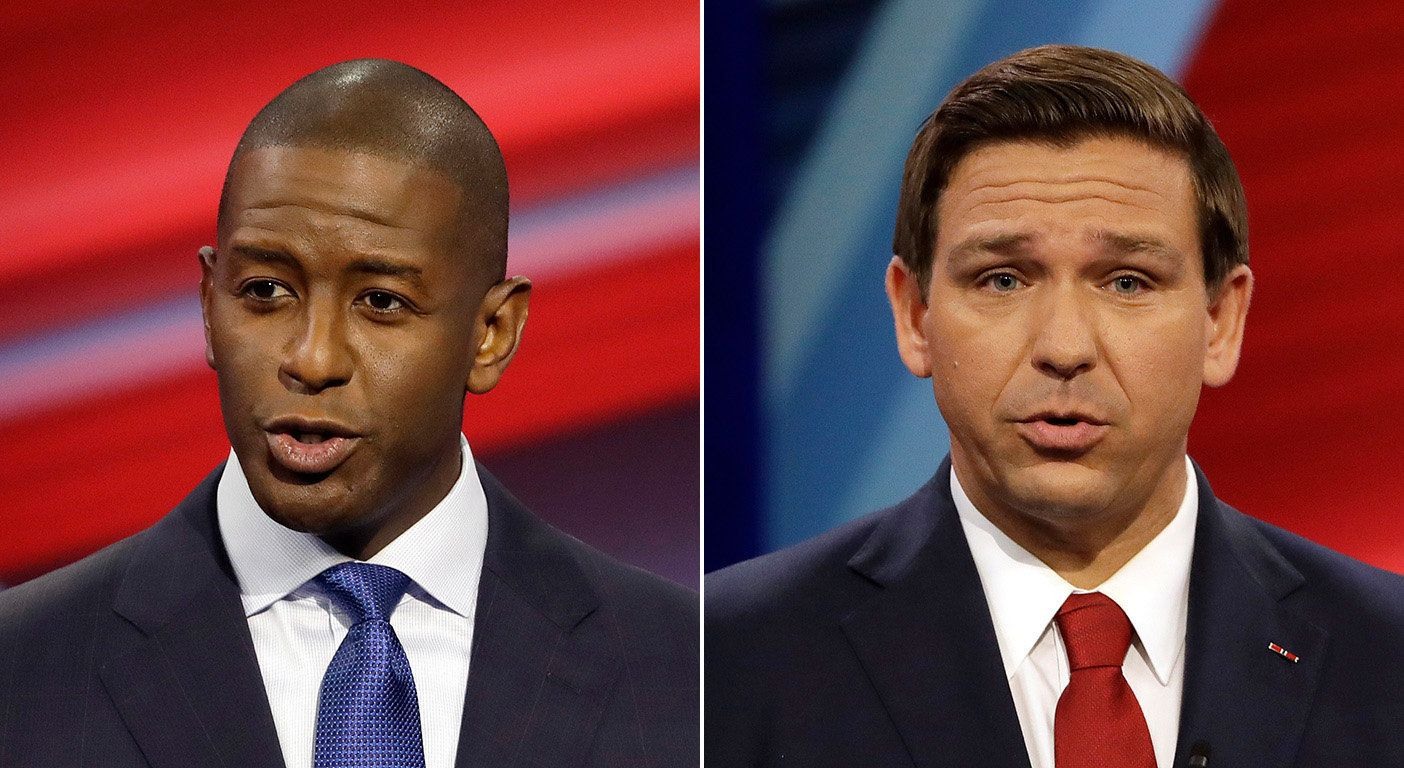 Andrew Gillum, left, and Ron DeSantis during Wednesday's Florida gubernatorial debate. (Getty Images)