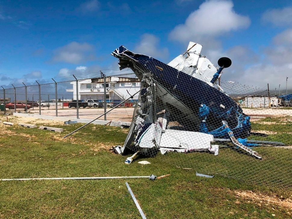 A damaged plane sits at the airport after Super Typhoon Yutu hit the U.S. Commonwealth of the Northern Mariana Islands on Fri