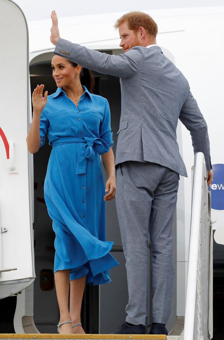 The Duchess of Sussex and Prince Harry wave goodbye before boarding their flight in Tonga.