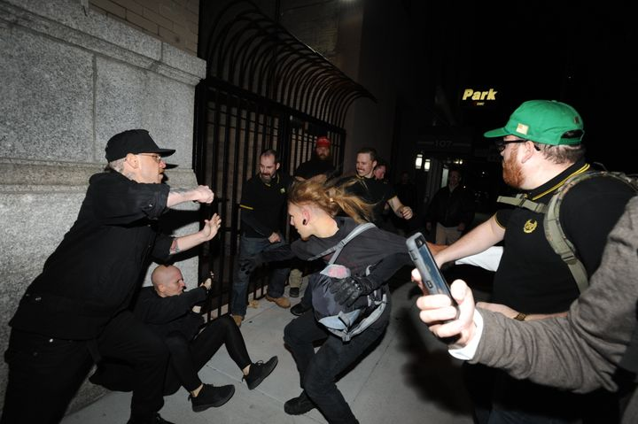 Protesters clash in Manhattan after an anti-Trump demonstrator (cowering on sidewalk) spit on a member of the Proud Boys whit