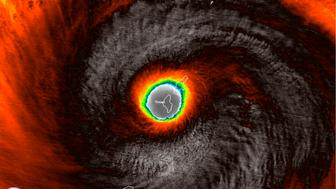 This false-color satellite image provided by the National Oceanic and Atmospheric Administration (NOAA) shows the moment the eye of Super Typhoon Yutu passed over Tinian, one of three main islands in the U.S. Commonwealth of the Northern Mariana Islands, producing damaging winds and high surf Wednesday, Oct. 24, 2018. The National Weather Service in Honolulu says maximum sustained winds of 180 mph (290 kph) were recorded around the eye of the storm, which passed over Tinian island and Saipan early Thursday morning local time. Waves of 25 to 40 feet (6 to 12 meters) are expected around the eye of the storm. (NOAA via AP)