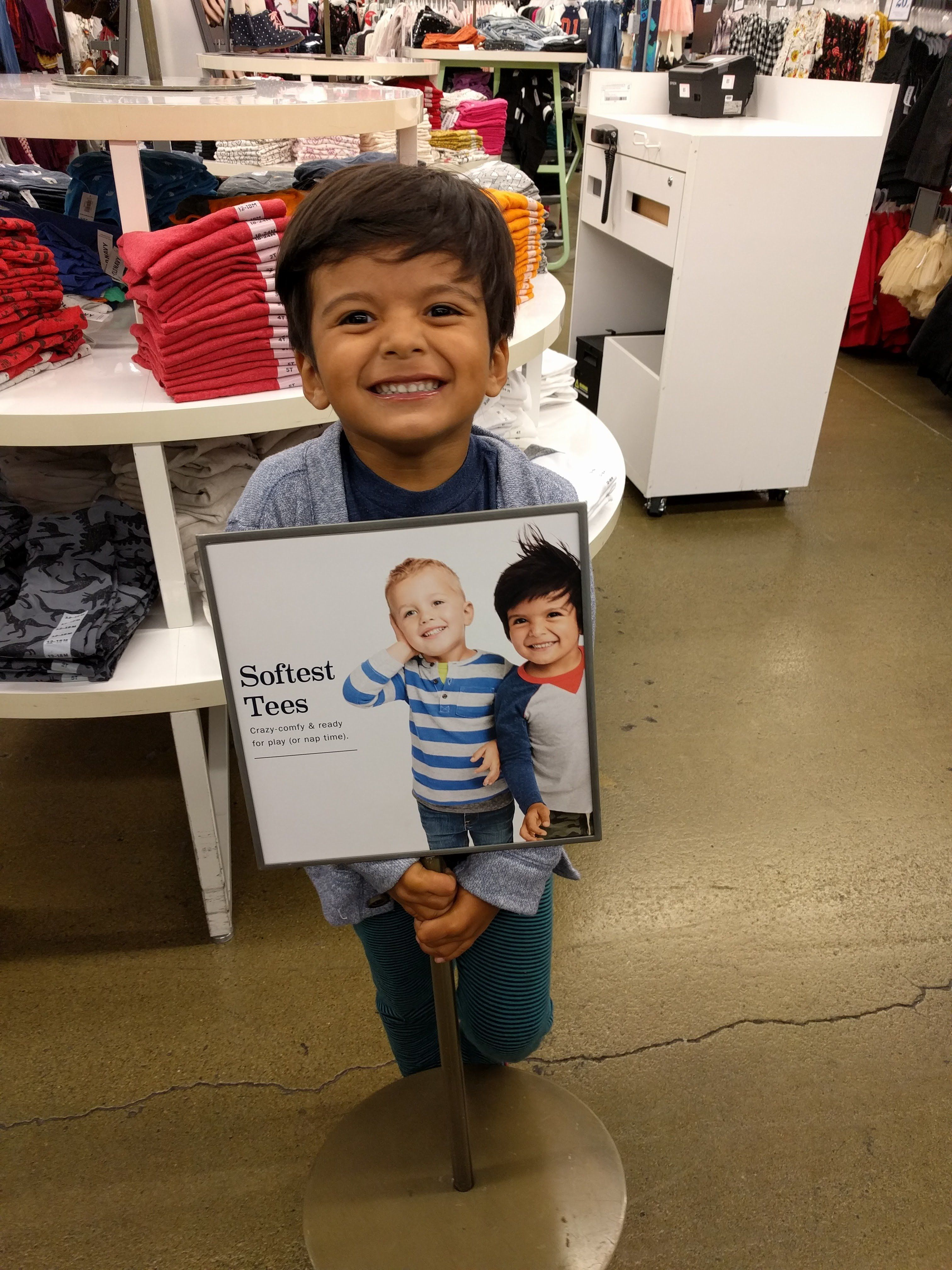 Standing next to his picture at Old Navy