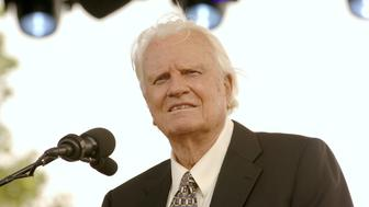 Billy Graham delivers his Farewell Message to a crowd of thousands on Day 3 of his final crusade at the Flushing Meadows Park in New York City, New York, on Sunday, June 26, 2005. (Photo by Jemal Countess/WireImage)