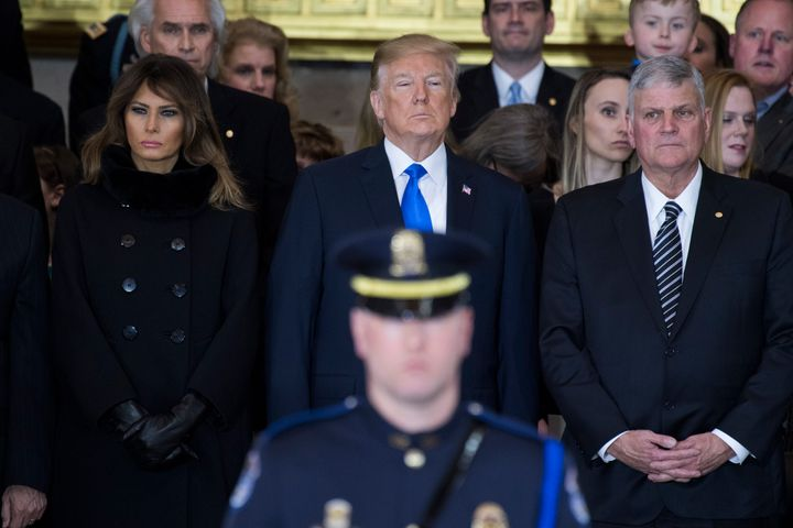 President Donald Trump, first lady Melania Trump and Franklin Graham attend a ceremony in the Capitol Rotunda as the late Rev