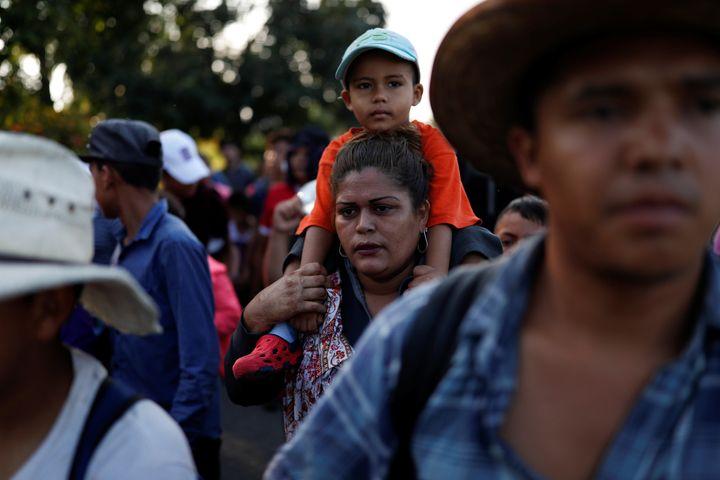 Central American migrants, part of a caravan trying to reach the U.S., walk along the road in Ciudad Hidalgo, Mexico.