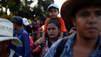 Central American migrants, part of a caravan trying to reach the U.S., walk along the road, in Ciudad Hidalgo, Mexico October 26, 2018. REUTERS/Carlos Garcia Rawlins