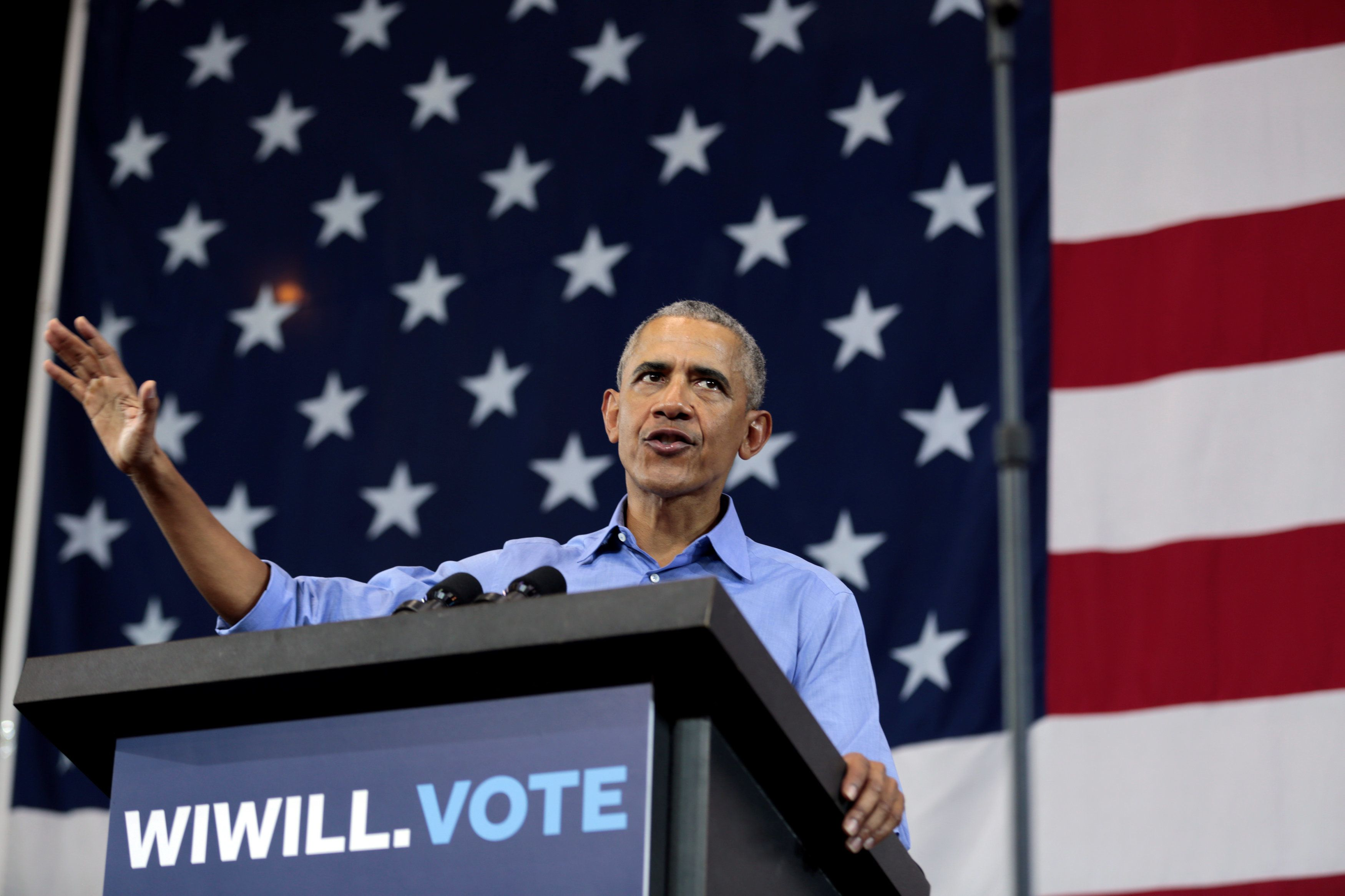 Former U.S. President Barack Obama speaks during a campaign rally for Democratic candidates Tony Evers and U.S. Senator Tammy Baldwin (D-WI) at North Division High School in Milwaukee, Wisconsin, U.S., October 26, 2018.     REUTERS/Sara Stathas