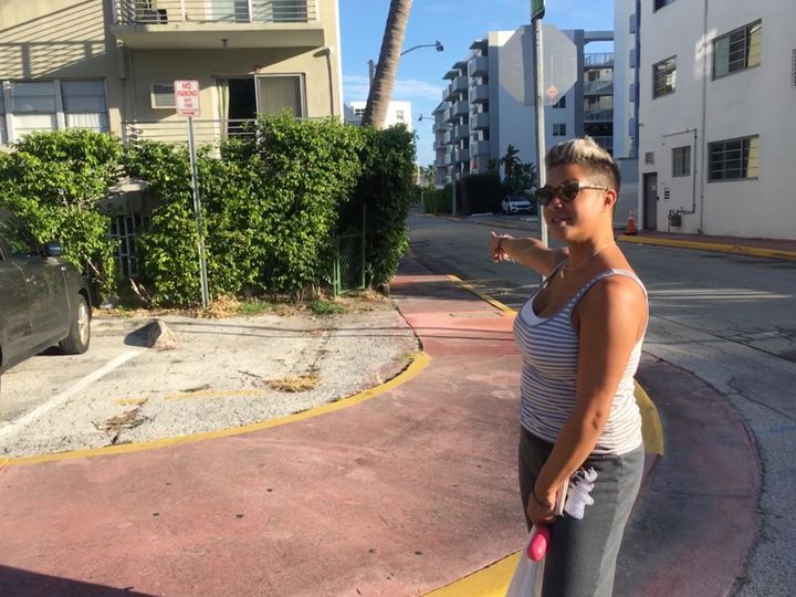 "Miami Beach resident Michelle DeLeon points to where the ""king tide"" floods enter the parking garage beneath her building eve"