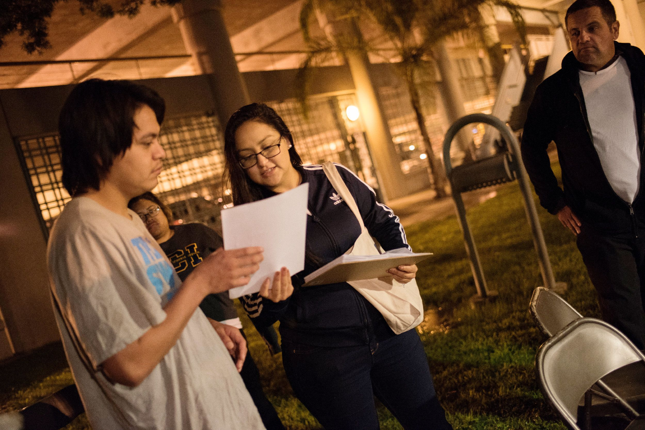 Santa Ana, California | October 5, 2018  Friday night, just after midnight, Daisy Ramirez (center with clipboard), the ACLU's Orange County jail project coordinator talks to a young man who was released from jail moments earlier about registering to vote and his rights as a citizen of California. (Melissa Lyttle for HuffPost)