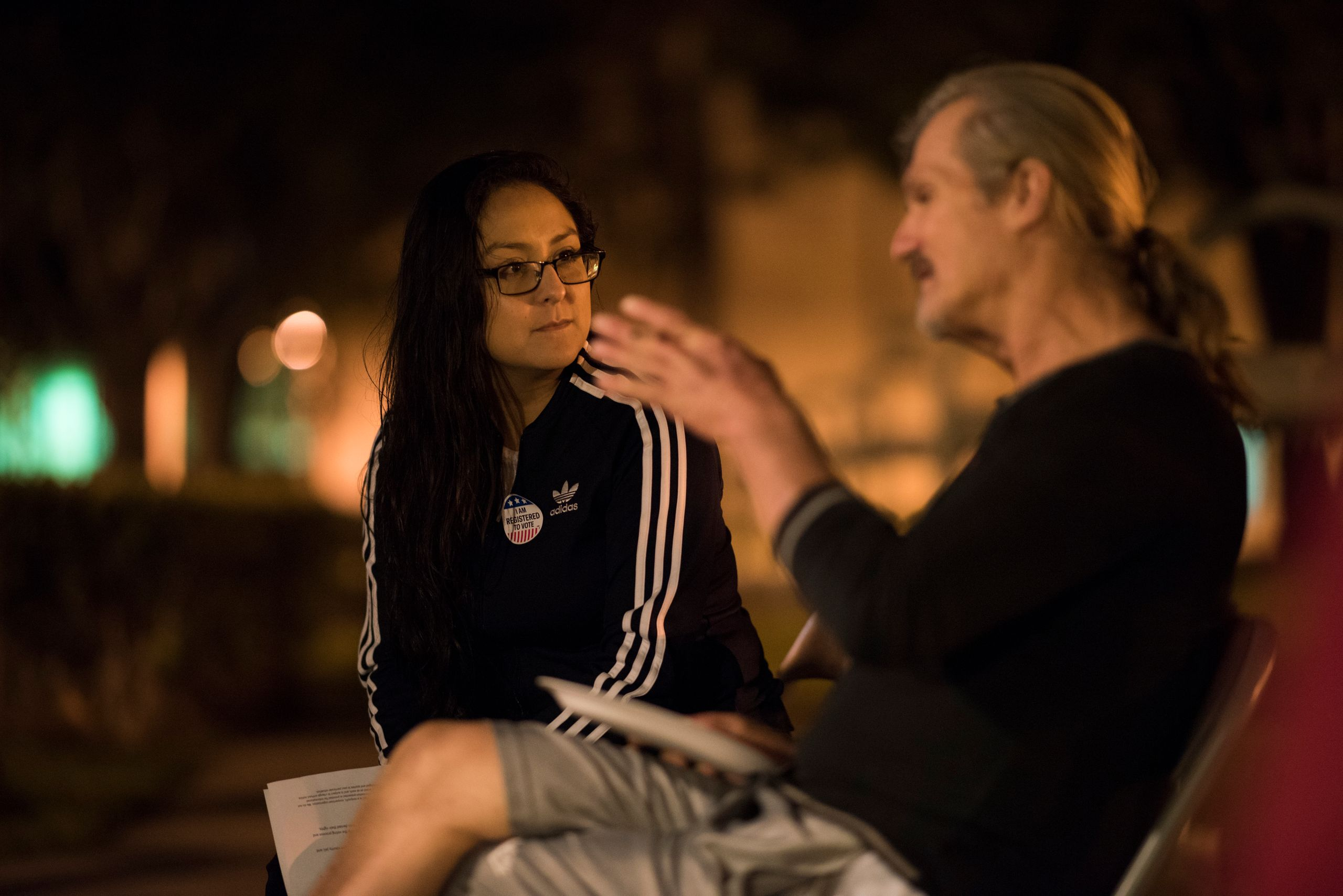 Daisy Ramirez, the ACLU's Orange County jail project coordinator, talks to Greg Compher, 58, about registering to vote and hi