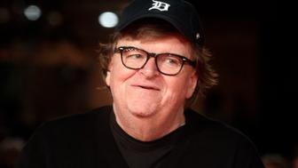 "Michael Moore poses for photographers on the red carpet of the movie ""Fahrenheit 11/9"" at the 13th edition of the Rome Film Fest, in Rome, Saturday, Oct. 20, 2018. (AP Photo/Gregorio Borgia)"
