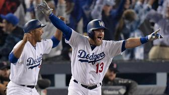 Los Angeles Dodgers' Max Muncy celebrates his walk off home run against the Boston Red Sox during the 18th inning in Game 3 of the World Series baseball game on Saturday, Oct. 27, 2018, in Los Angeles. (AP Photo/Mark J. Terrill)