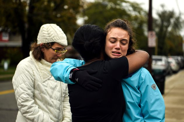 From left, Kate Rothstein looks on as Tammy Hepps hugs Simone Rothstein, 16, on the intersection of Shady...